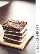 Купить «chocolate fudge with nuts, each piece is packed separately», фото № 29249671, снято 17 января 2014 г. (c) Tetiana Chugunova / Фотобанк Лори