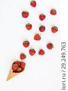 Купить «Waffle cone with fresh strawberries, top view, isolated on white», фото № 29249763, снято 18 июня 2017 г. (c) Tetiana Chugunova / Фотобанк Лори