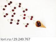 Купить «Waffle cone with fresh cherry berries, top view, isolated on whi», фото № 29249767, снято 18 июня 2017 г. (c) Tetiana Chugunova / Фотобанк Лори