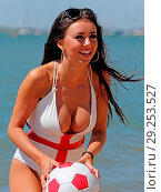 Купить «Ex Voice star the gorgeous Lydia Lucy goes all patriotic on the beach at Leigh on Sea Essex n her England themed bikini earlier today. Featuring: Voice...», фото № 29253527, снято 26 июня 2018 г. (c) age Fotostock / Фотобанк Лори