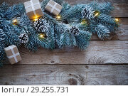 Christmas fir on dark wooden background. Стоковое фото, фотограф Майя Крученкова / Фотобанк Лори