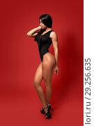 Купить «Beautiful woman with long dark hair posing in black bodysuit and heels», фото № 29256635, снято 4 октября 2018 г. (c) Restyler Viacheslav / Фотобанк Лори