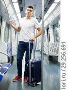 Купить «Passenger with baggage in subway», фото № 29256691, снято 24 августа 2018 г. (c) Яков Филимонов / Фотобанк Лори
