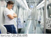 Купить «Man in white shirt traveling on subway», фото № 29256695, снято 24 августа 2018 г. (c) Яков Филимонов / Фотобанк Лори