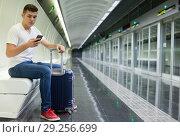 Купить «Man traveling on subway and using smartphone», фото № 29256699, снято 24 августа 2018 г. (c) Яков Филимонов / Фотобанк Лори
