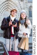 Купить «Tourists standing with camera», фото № 29256843, снято 18 ноября 2017 г. (c) Яков Филимонов / Фотобанк Лори