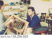 Купить «Carpenter taking chair for repairing», фото № 29256923, снято 8 апреля 2017 г. (c) Яков Филимонов / Фотобанк Лори