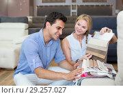 Купить «Family who are choosing colors for new sofa», фото № 29257027, снято 19 июня 2017 г. (c) Яков Филимонов / Фотобанк Лори