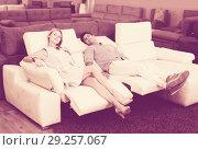 Купить «Couple who are choosing new sofa-transformer», фото № 29257067, снято 19 июня 2017 г. (c) Яков Филимонов / Фотобанк Лори
