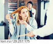 Купить «Unhappy woman in hairdress salon», фото № 29257175, снято 7 марта 2017 г. (c) Яков Филимонов / Фотобанк Лори