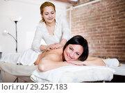 Купить «Glad adult woman likes work of young masseur», фото № 29257183, снято 7 марта 2017 г. (c) Яков Филимонов / Фотобанк Лори