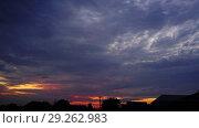 Купить «Timelapse with sunset sky over houses village», видеоролик № 29262983, снято 27 сентября 2018 г. (c) Михаил Коханчиков / Фотобанк Лори