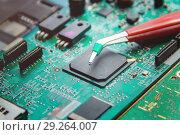 Купить «Printed Circuit Board with many electrical components», фото № 29264007, снято 25 сентября 2018 г. (c) Максим Бейков / Фотобанк Лори