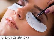 Купить «Young woman getting eyelash extension», фото № 29264575, снято 29 января 2018 г. (c) Elnur / Фотобанк Лори