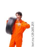 Купить «Young garage worker with tyre isolated on white», фото № 29265251, снято 21 июля 2018 г. (c) Elnur / Фотобанк Лори