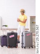 Купить «Man going on vacation with fragile suitcases», фото № 29270567, снято 4 июля 2018 г. (c) Elnur / Фотобанк Лори