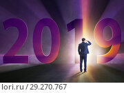 Купить «Businessman in the concept of transition to year 2019», фото № 29270767, снято 19 ноября 2018 г. (c) Elnur / Фотобанк Лори