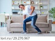 Купить «Sick man suffering at home from infection and bad stomach», фото № 29270967, снято 5 апреля 2017 г. (c) Elnur / Фотобанк Лори