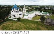 Купить «Aerial panoramic view of Cathedral of Nativity of Virgin in Suzdal Kremlin on cloudy summer day, Russia», видеоролик № 29271151, снято 29 июня 2018 г. (c) Яков Филимонов / Фотобанк Лори