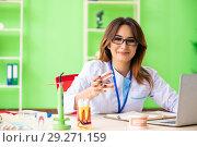 Купить «Woman dentist working on teeth implant», фото № 29271159, снято 11 июня 2018 г. (c) Elnur / Фотобанк Лори