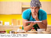 Купить «Man cook preparing cake in kitchen at home», фото № 29271367, снято 13 июня 2018 г. (c) Elnur / Фотобанк Лори