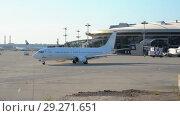 Купить «Official spotting, Utair Aircraft performs taxiing before takeoff», видеоролик № 29271651, снято 1 августа 2018 г. (c) Андрей Радченко / Фотобанк Лори