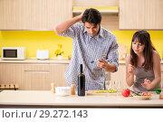 Купить «Young couple celebrating wedding anniversary at kitchen», фото № 29272143, снято 26 июня 2018 г. (c) Elnur / Фотобанк Лори