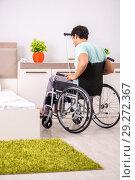 Купить «Young handsome disabled man recovering at home», фото № 29272367, снято 28 июня 2018 г. (c) Elnur / Фотобанк Лори