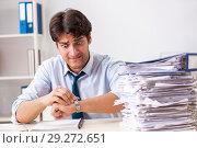 Купить «Overloaded busy employee with too much work and paperwork», фото № 29272651, снято 3 июля 2018 г. (c) Elnur / Фотобанк Лори