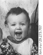 Купить «Старая фотография смеющейся двухлетней девочки. 1957. Из домашнего архива», фото № 29273707, снято 21 октября 2018 г. (c) Валерия Попова / Фотобанк Лори