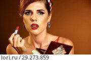 Купить «Girl in pin up retro style make make up.», фото № 29273859, снято 14 ноября 2018 г. (c) Gennadiy Poznyakov / Фотобанк Лори