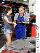 Купить «Worried client emotionally talking to elderly man mechanic», фото № 29274031, снято 4 сентября 2018 г. (c) Яков Филимонов / Фотобанк Лори