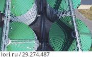 Купить «Flight over a modern granary», видеоролик № 29274487, снято 25 августа 2018 г. (c) Андрей Радченко / Фотобанк Лори