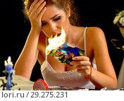 Burning photography wedding bride sitting table. Quarrel honeymoon. Wedding memories. Стоковое фото, фотограф Gennadiy Poznyakov / Фотобанк Лори
