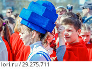 Купить «Russia, Samara, April 12, 2016: a young beautiful girl dressed with space theme, on holiday, Cosmonautics Day, in the square with a space rocket, on a spring sunny day.», фото № 29275711, снято 12 апреля 2016 г. (c) Акиньшин Владимир / Фотобанк Лори