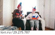 Купить «Two elderly women watching in russian accessories TV», видеоролик № 29275787, снято 18 ноября 2018 г. (c) Константин Шишкин / Фотобанк Лори