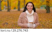 Купить «woman drinking takeaway coffee in autumn park», видеоролик № 29276743, снято 18 октября 2018 г. (c) Syda Productions / Фотобанк Лори