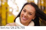 Купить «happy young woman smiling in autumn park», видеоролик № 29276755, снято 18 октября 2018 г. (c) Syda Productions / Фотобанк Лори