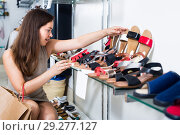 Young woman choosing shoes in store. Стоковое фото, фотограф Яков Филимонов / Фотобанк Лори