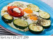 Купить «Photography of plate with scrambled eggs with zucchini and tomato», фото № 29277299, снято 17 ноября 2018 г. (c) Яков Филимонов / Фотобанк Лори