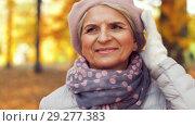 Купить «happy senior woman walking along autumn park», видеоролик № 29277383, снято 22 октября 2018 г. (c) Syda Productions / Фотобанк Лори