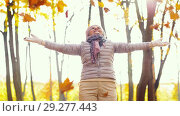Купить «happy senior woman throwing autumn leaves up», видеоролик № 29277443, снято 22 октября 2018 г. (c) Syda Productions / Фотобанк Лори