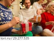 Купить «close up of friends opening christmas gifts», фото № 29277535, снято 17 декабря 2017 г. (c) Syda Productions / Фотобанк Лори