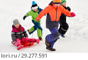 Купить «happy kids with sled having fun outdoors in winter», фото № 29277591, снято 10 февраля 2018 г. (c) Syda Productions / Фотобанк Лори