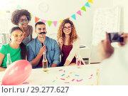 Купить «friends or team photographing at office party», фото № 29277627, снято 3 сентября 2017 г. (c) Syda Productions / Фотобанк Лори