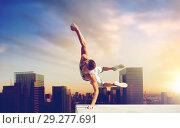 Купить «man making parkour jumping over tokyo city», фото № 29277691, снято 25 августа 2015 г. (c) Syda Productions / Фотобанк Лори