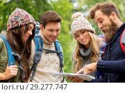 Купить «friends or travelers hiking with backpacks and map», фото № 29277747, снято 31 августа 2014 г. (c) Syda Productions / Фотобанк Лори