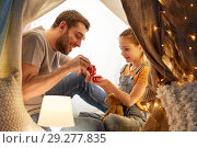 Купить «family playing tea party in kids tent at home», фото № 29277835, снято 27 января 2018 г. (c) Syda Productions / Фотобанк Лори