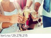 Купить «friends clinking glasses of champagne at party», фото № 29278215, снято 3 сентября 2017 г. (c) Syda Productions / Фотобанк Лори