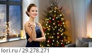 Купить «beautiful woman at home over christmas tree lights», фото № 29278271, снято 1 июня 2014 г. (c) Syda Productions / Фотобанк Лори